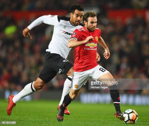 Juan Mata of Manchester United is chased by Tom Huddlestone of Derby County during the Emirates FA Cup Third Round match between Manchester United...