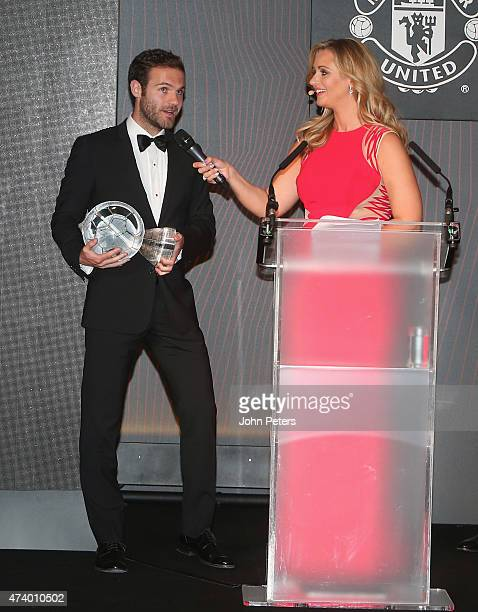 Juan Mata of Manchester United is interviewed by host Hayley McQueen after winning the Sir Matt Busby Player of the Year trophy at the Manchester...
