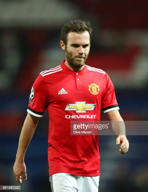Juan Mata of Manchester United looks dejected in defeat after the UEFA Champions League Round of 16 Second Leg match between Manchester United and...