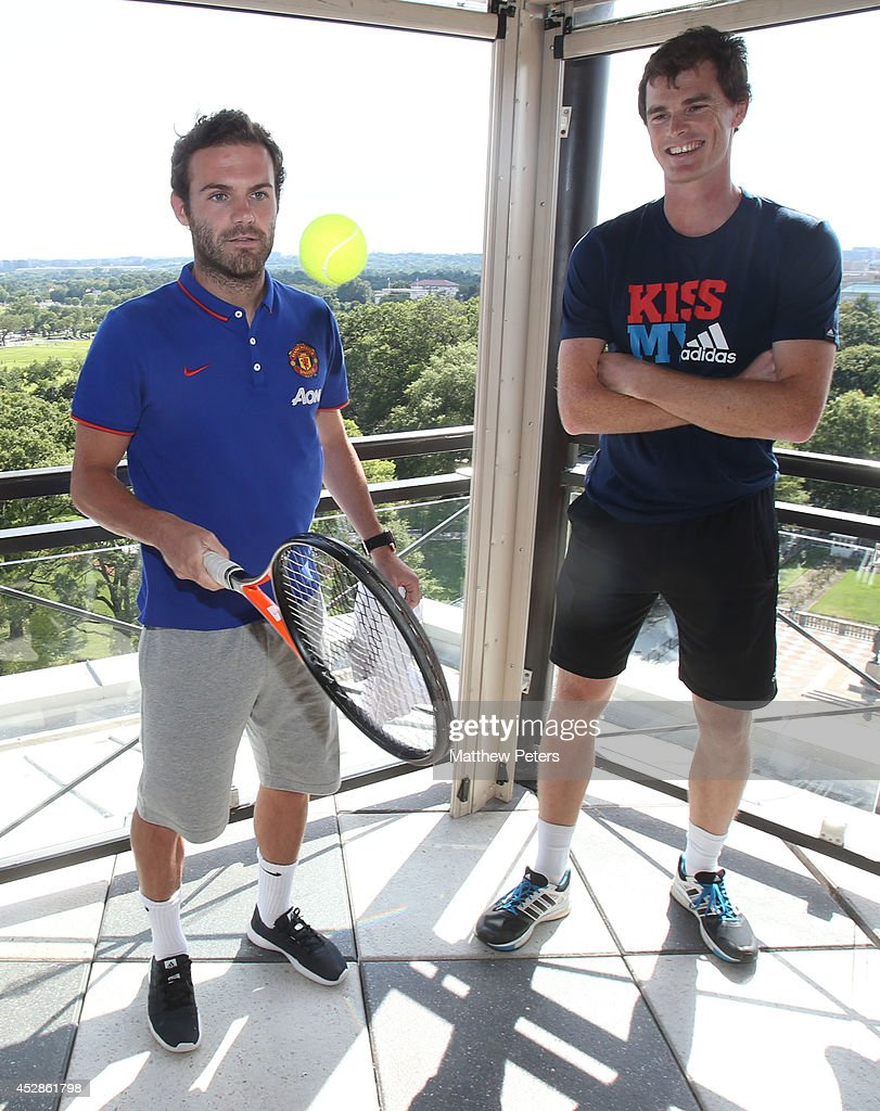 (MINIMUM PRINT/BROADCAST FEE OF GBP 150, ONLINE FEE OF GBP 75 PER IMAGE, OR LOCAL EQUIVALENT) Juan Mata of Manchester United meets tennis player Jamie Murray who is playing in the Citi Open, at their hotel on July 28, 2014 in Washington, DC.