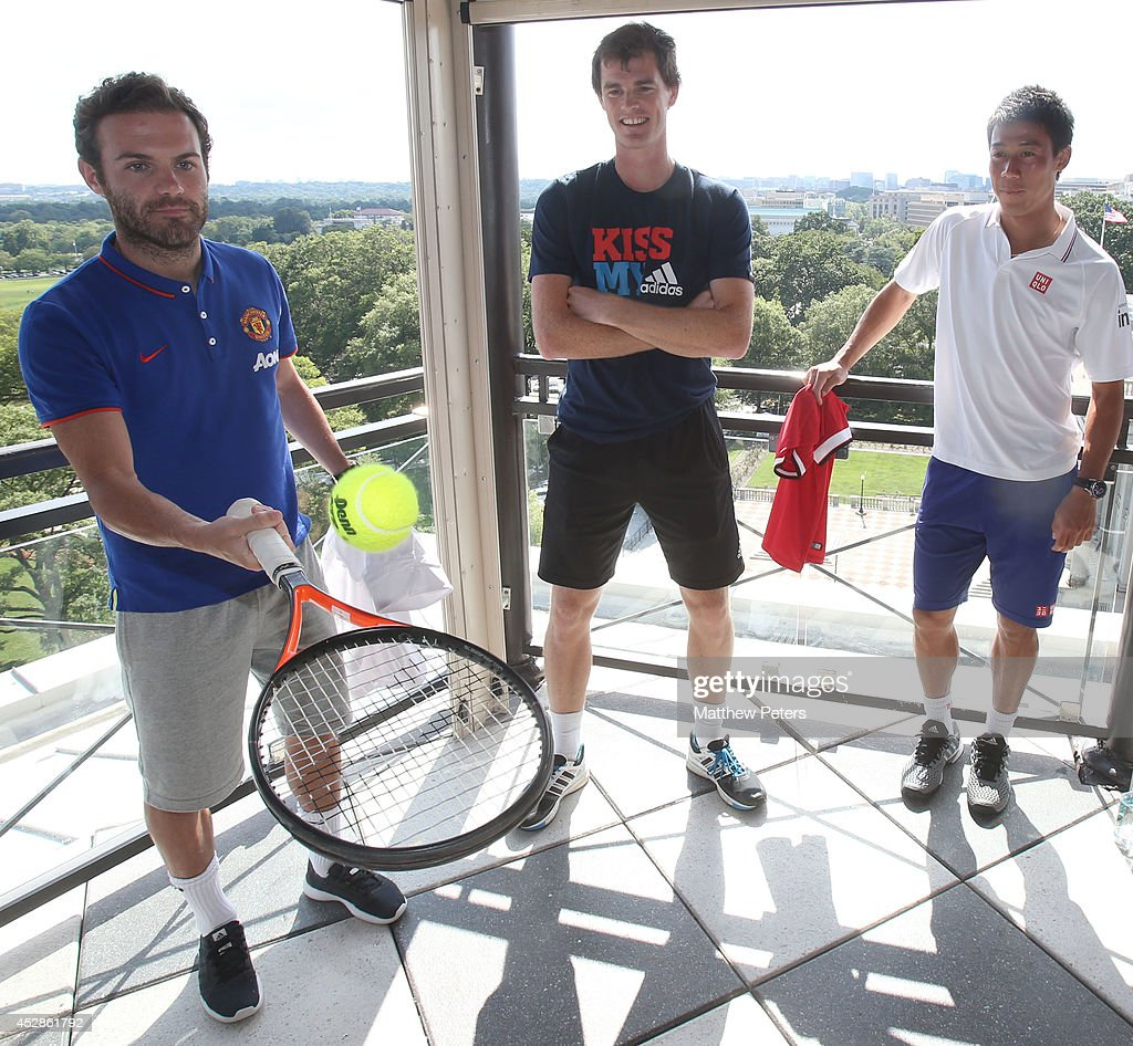 (MINIMUM PRINT/BROADCAST FEE OF GBP 150, ONLINE FEE OF GBP 75 PER IMAGE, OR LOCAL EQUIVALENT) Juan Mata of Manchester United meets tennis players Kei Nishikori and Jamie Murray who are playing in the Citi Open, at their hotel on July 28, 2014 in Washington, DC.