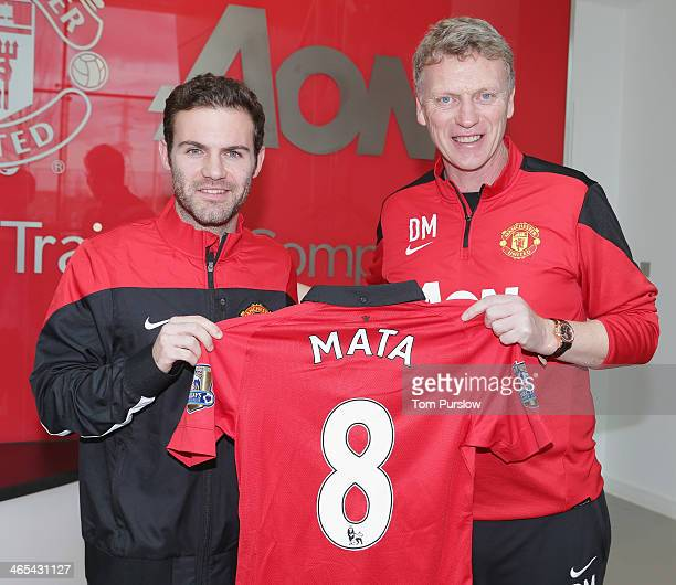 Juan Mata of Manchester United poses with his number 8 shirt ahead of the press conference to announce his signing at Aon Training Complex on January...