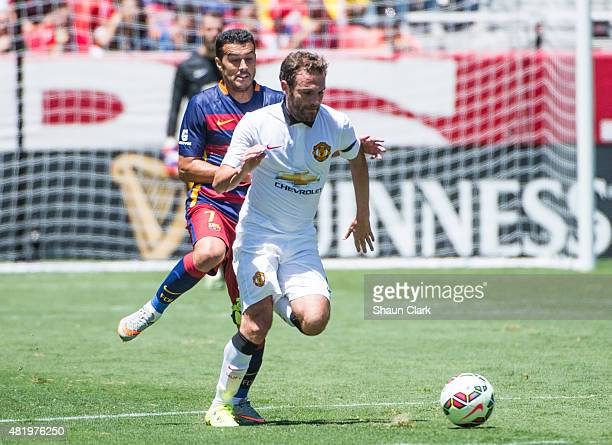 Juan Mata of Manchester United races upfield as Pedro of Barcelona chases during the International Champions Cup 2015 match between FC Barcelona and...