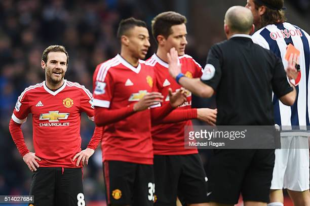 Juan Mata of Manchester United reacts after being sent off by referee Mike Dean during the Barclays Premier League match between West Bromwich Albion...
