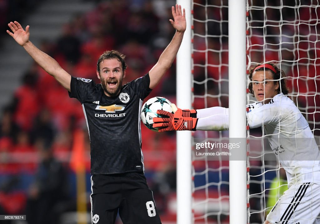 Juan Mata of Manchester United reacts as and appeals for a goal as Mile Svilar of Benfica attempts to stop the ball from crossing the line, a goal is later given to Marcus Rashford of Manchester United (not pictured) during the UEFA Champions League group A match between SL Benfica and Manchester United at Estadio da Luz on October 18, 2017 in Lisbon, Portugal.