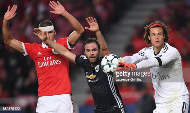 Juan Mata of Manchester United reacts as and appeals for a goal as Mile Svilar of Benfica attempts to stop the ball from crossing the line a goal is...