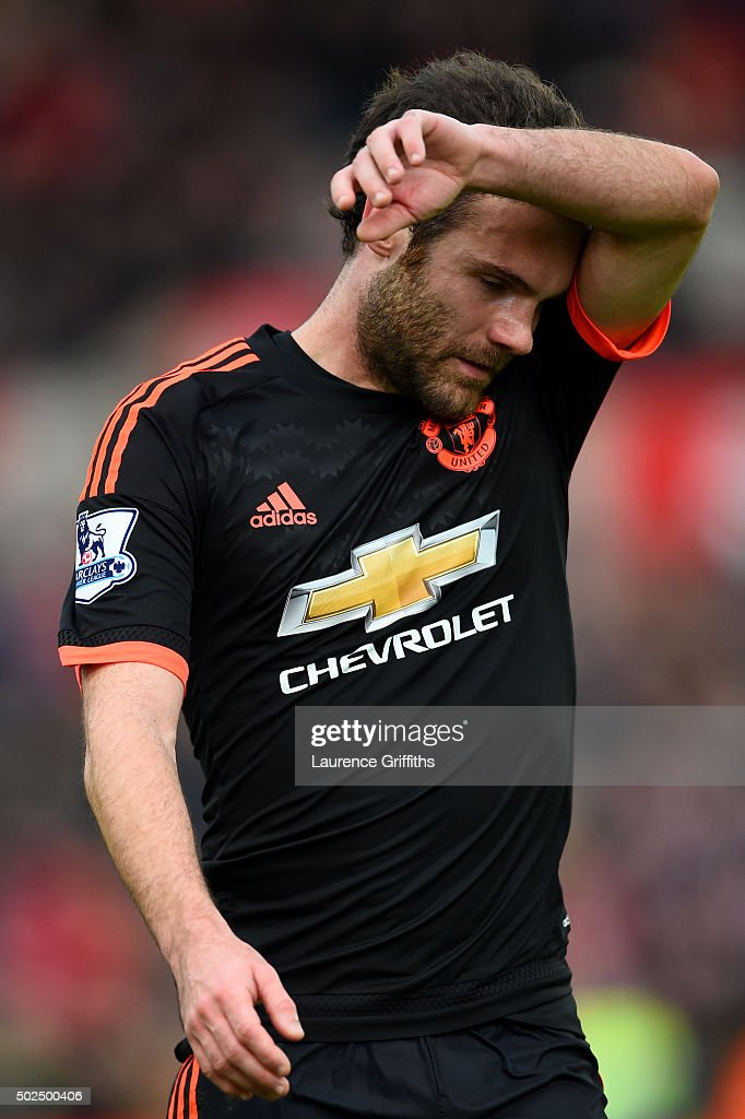 Juan Mata of Manchester United reacts as he leaves the pitch after the Barclays Premier League match between Stoke City and Manchester United at Britannia Stadium on December 26, 2015 in Stoke on Trent, England.