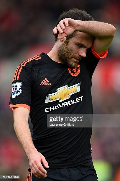 Juan Mata of Manchester United reacts as he leaves the pitch after the Barclays Premier League match between Stoke City and Manchester United at...