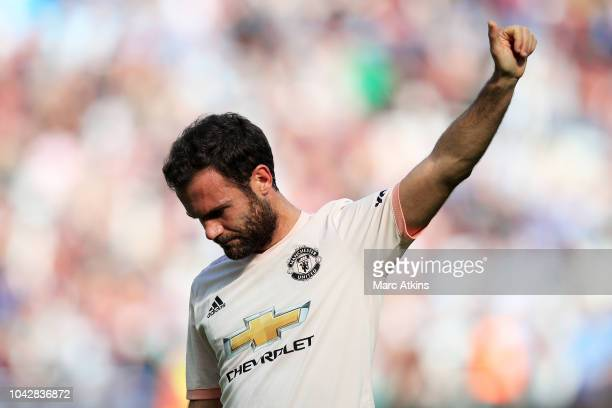 Juan Mata of Manchester United reacts at full time after the Premier League match between West Ham United and Manchester United at London Stadium on...