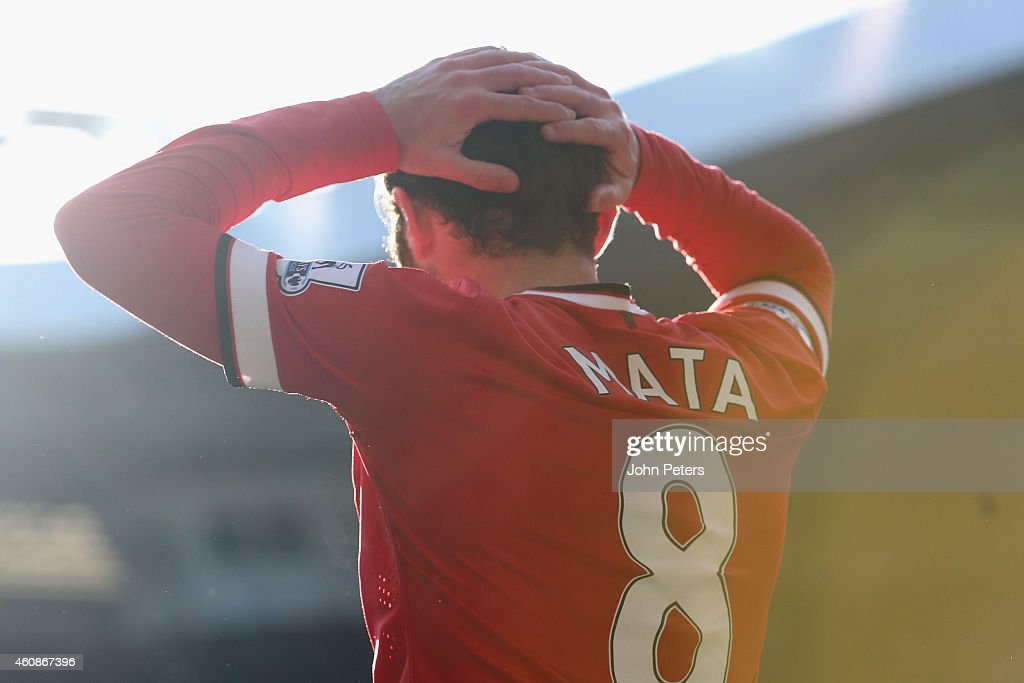 Juan Mata of Manchester United reacts to a missed chance during the Barclays Premier League match between Tottenham Hotspur and Manchester United at White Hart Lane on December 28, 2014 in London, England.