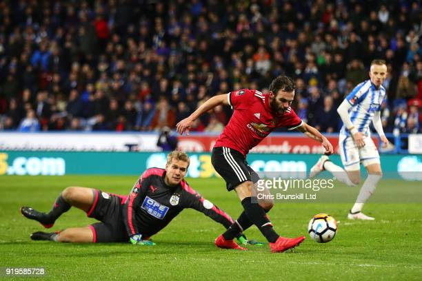 Juan Mata of Manchester United rounds Jonas Lossl of Huddersfield Town and puts the ball in the net before it is subsequently ruled out by the VAR...