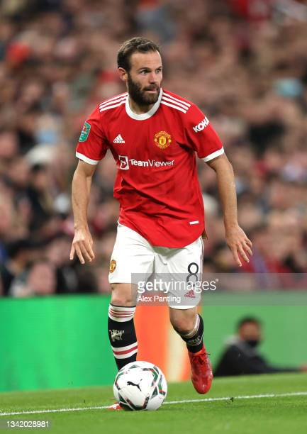 Juan Mata of Manchester United runs with the ball during the Carabao Cup Third Round match between Manchester United and West Ham United at Old...