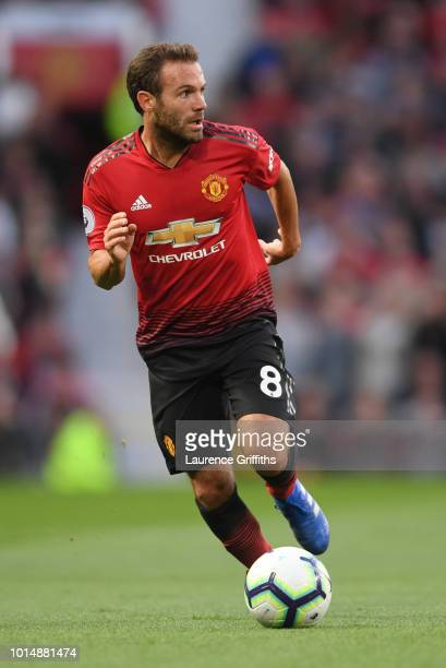 Juan Mata of Manchester United runs with the ball during the Premier League match between Manchester United and Leicester City at Old Trafford on...