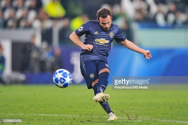 Juan Mata of Manchester United scores a goal during the Group H match of the UEFA Champions League between Juventus and Manchester United at on...