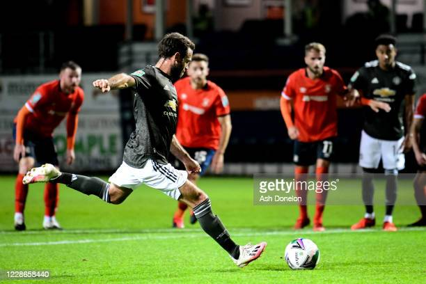 Juan Mata of Manchester United scores a penalty to make the score 0-1 during the Carabao Cup Third Round match between Luton Town and Manchester...