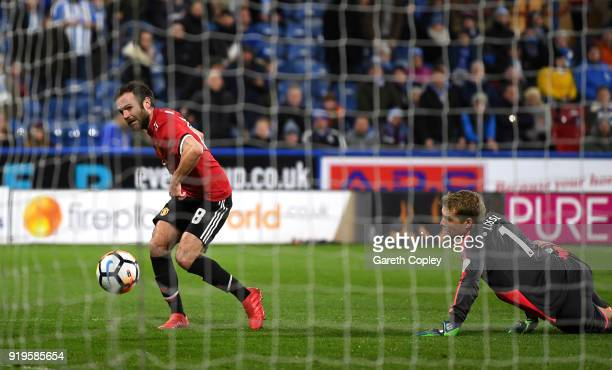 Juan Mata of Manchester United scores his sides second goal which is then deemed offside during the The Emirates FA Cup Fifth Round between...