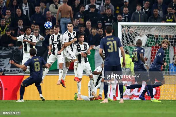 Juan Mata of Manchester United scores his team's first goal during the UEFA Champions League Group H match between Juventus and Manchester United at...