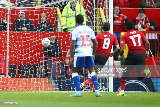 Juan Mata of Manchester United scores his team's first goal from the penalty spot during the FA Cup Third Round match between Manchester United and...