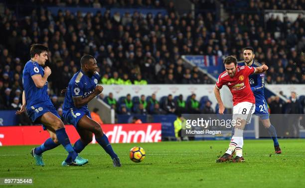 Juan Mata of Manchester United scores his team's opening goal during the Premier League match between Leicester City and Manchester United at The...