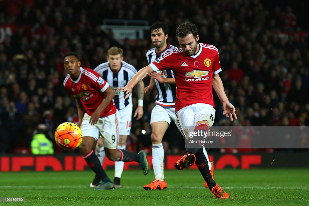 Juan Mata of Manchester United scores his team's second goal from the penalty spot during the Barclays Premier League match between Manchester United and West Bromwich Albion at Old Trafford on November 7, 2015 in Manchester, England.