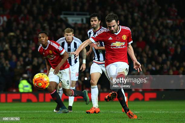 Juan Mata of Manchester United scores his team's second goal from the penalty spot during the Barclays Premier League match between Manchester United...