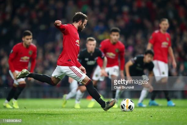 Juan Mata of Manchester United scores his team's third goal during the UEFA Europa League group L match between Manchester United and AZ Alkmaar at...