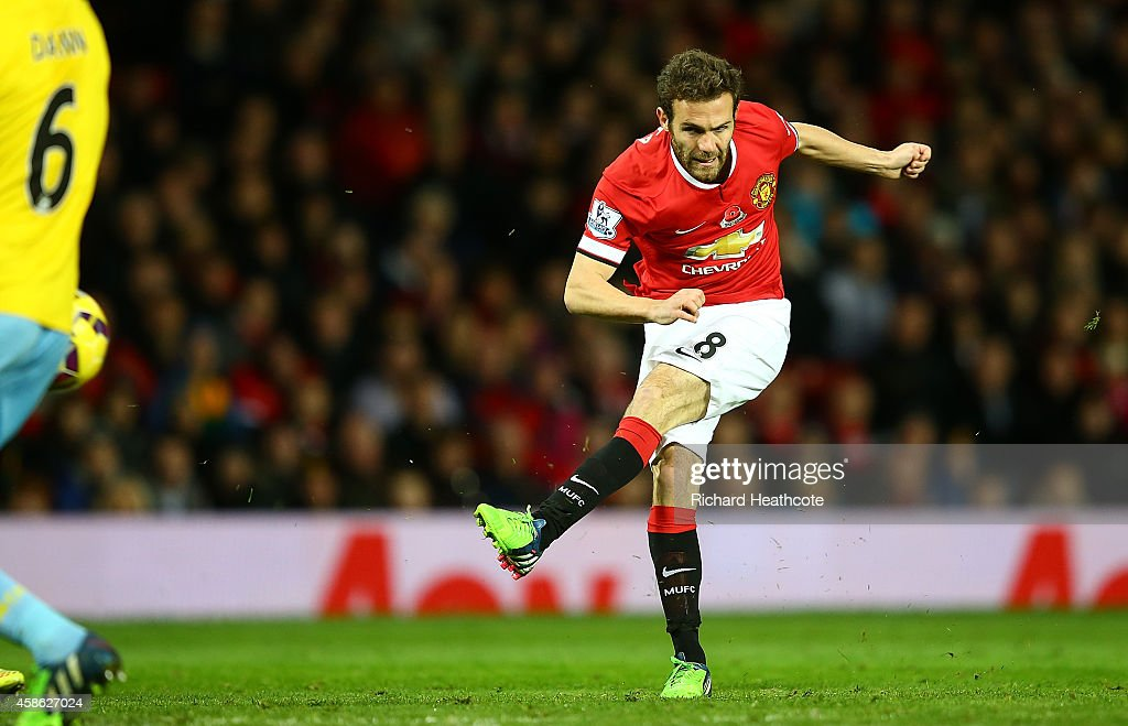 Juan Mata of Manchester United scores the first goal during the Barclays Premier League match between Manchester United and Crystal Palace at Old Trafford on November 8, 2014 in Manchester, England.