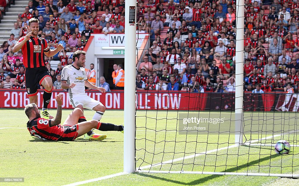 Juan Mata of Manchester United scores the first goal to make the score 0-1 during the Premier League match between AFC Bournemouth and Manchester United at Vitality Stadium on August 14, 2016 in Bournemouth, England.