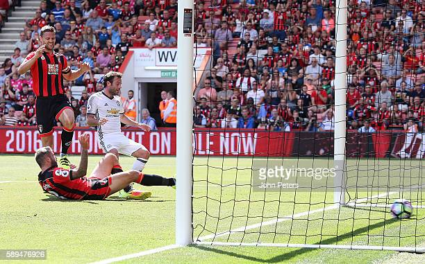 Juan Mata of Manchester United scores the first goal to make the score 01 during the Premier League match between AFC Bournemouth and Manchester...