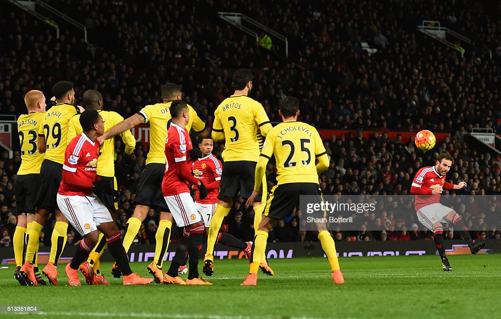 Juan Mata of Manchester United scores the opening goal from a free kick during the Barclays Premier League match between Manchester United and Watford at Old Trafford on March 2, 2016 in Manchester, England.