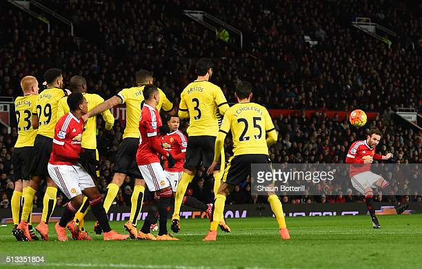 Juan Mata of Manchester United scores the opening goal from a free kick during the Barclays Premier League match between Manchester United and...