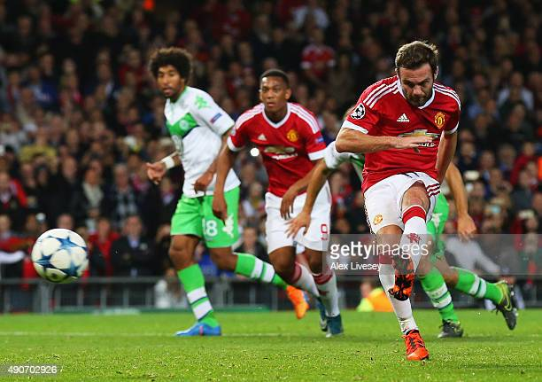 Juan Mata of Manchester United scores their first and equalising goal from the penalty spot during the UEFA Champions League Group B match between...