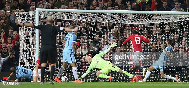 Juan Mata of Manchester United scores their first goal during the EFL Cup Fourth Round match between Manchester United and Manchester City at Old...