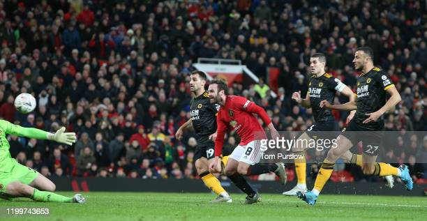 Juan Mata of Manchester United scores their first goal during the FA Cup Third Round Replay match between Manchester United and Wolverhampton...