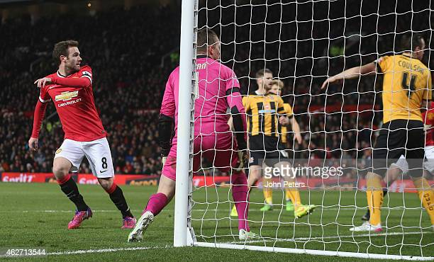 Juan Mata of Manchester United scores their first goal during the FA Cup Fourth Round replay between Manchester United and Cambridge United at Old...