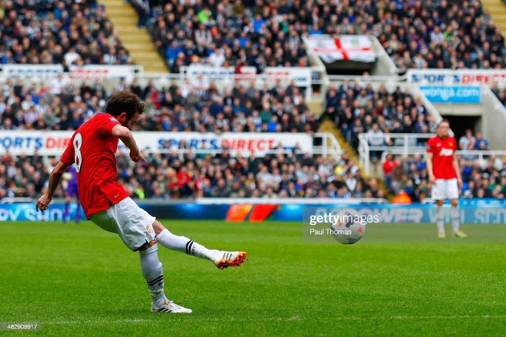Juan Mata of Manchester United scores their first goal during the Barclays Premier League match between Newcastle United and Manchester United at St James' Park on April 5, 2014 in Newcastle upon Tyne, England.