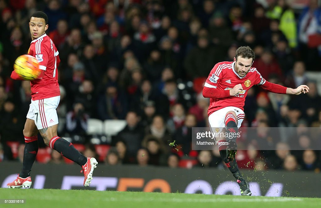 Juan Mata of Manchester United scores their first goal during the Barclays Premier League match between Manchester United and Watford at Old Trafford on March 2, 2016 in Manchester, England.