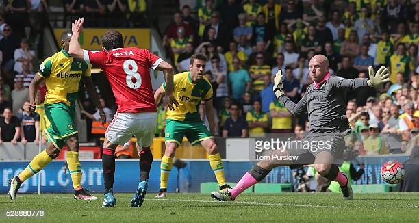 Juan Mata of Manchester United scores their first goal during the Barclays Premier League match between Norwich City and Manchester United at Carrow...