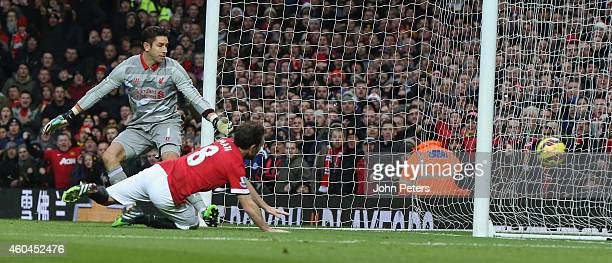 Juan Mata of Manchester United scores their second goal during the Barclays Premier League match between Manchester United and Liverpool at Old...