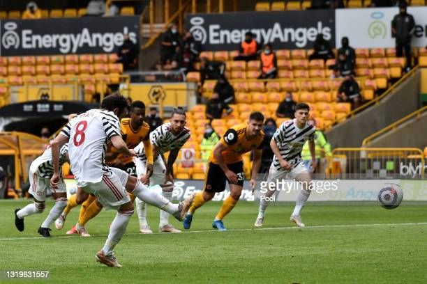 Juan Mata of Manchester United scores their team's second goal from the penalty spot during the Premier League match between Wolverhampton Wanderers...