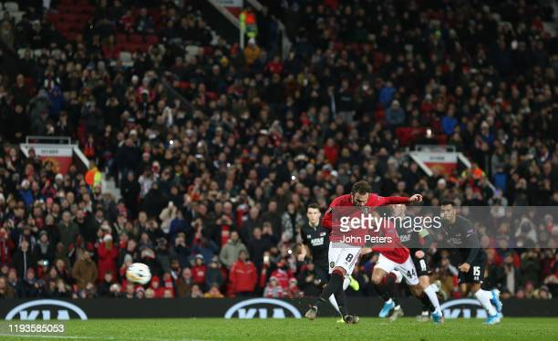 Juan Mata of Manchester United scores their third goal during the UEFA Europa League group L match between Manchester United and AZ Alkmaar at Old...