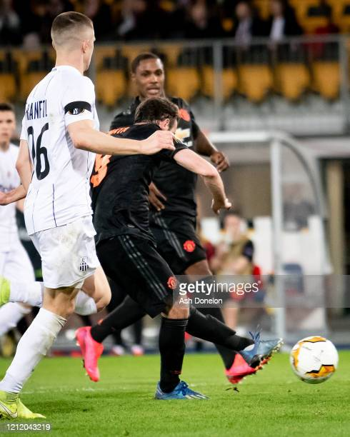 Juan Mata of Manchester United scores their third goal during the UEFA Europa League round of 16 first leg match between LASK and Manchester United...