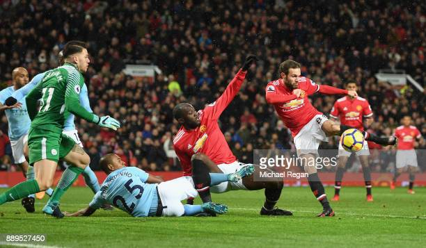 Juan Mata of Manchester United sees his chance saved by Ederson of Manchester City during the Premier League match between Manchester United and...