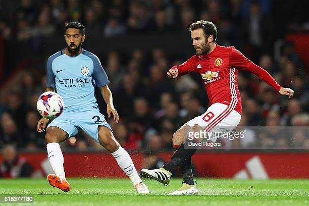 Juan Mata of Manchester United shoots during the EFL Cup fourth round match between Manchester United and Manchester City at Old Trafford on October...