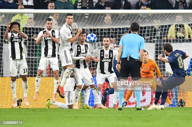 Juan Mata of Manchester United shoots past Cristiano Ronaldo of Juventus to score a goal during the Group H match of the UEFA Champions League...