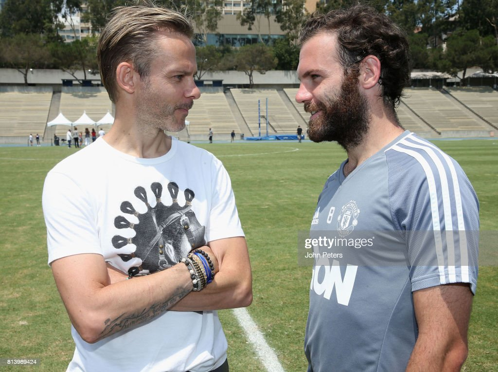 Juan Mata of Manchester United talks with actor Dominic Monaghan ahead of a first team training session as part of their pre-season tour of the USA at UCLA on July 13, 2017 in Los Angeles, California.