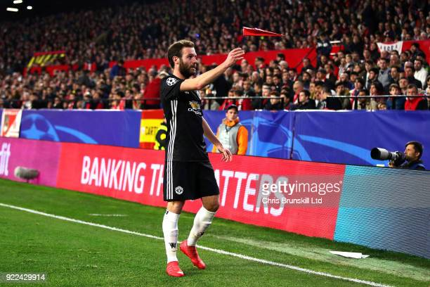 Juan Mata of Manchester United throws a paper aeroplane during the UEFA Champions League Round of 16 First Leg match between Sevilla FC and...