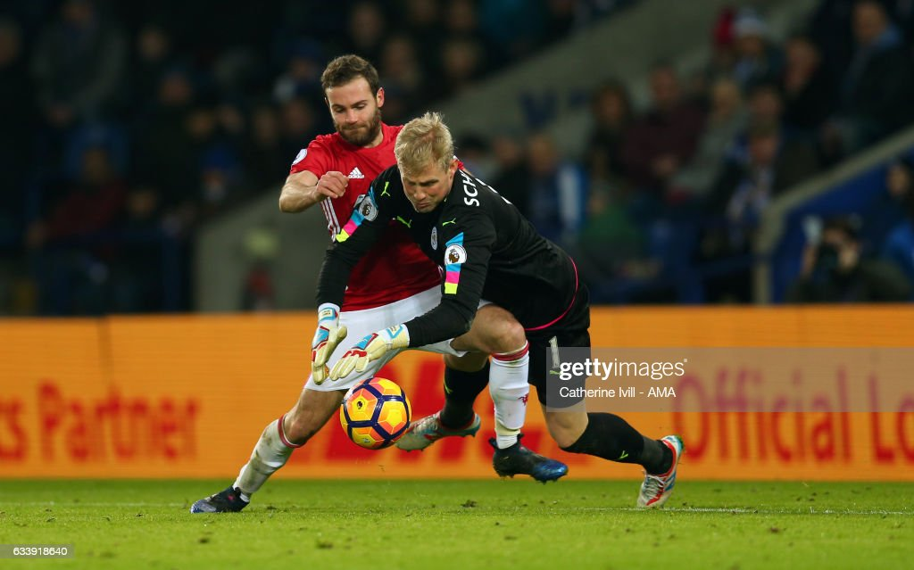 Juan Mata of Manchester United tries to take advantage as Leicester City goalkeeper Kasper Schmeichel fumbles the ball during the Premier League match between Leicester City and Manchester United at The King Power Stadium on February 5, 2017 in Leicester, England.