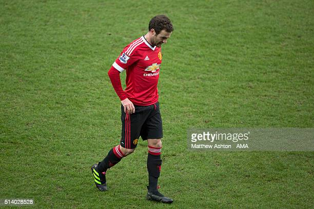 Juan Mata of Manchester United walks off after being shown a red card during the Barclays Premier League match between West Bromwich Albion and...