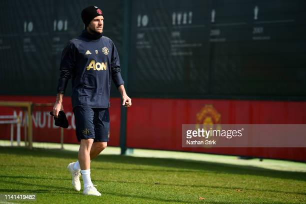 Juan Mata of Manchester United walks off after the Manchester United training session ahead of the UEFA Champions League Quarter Final First Leg...